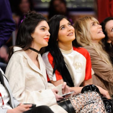 Kendall & Kylie Jenner Wear Thigh High Boots To Lakers Game